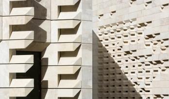 """镂空的石材立面——伦佐·皮亚诺设计的""""城市之门""""项目"""