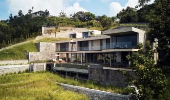 虚实之间,石材与玻璃的协作曲 — Maleo 住宅