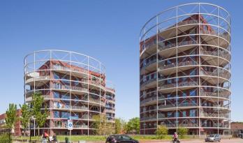 后工业风与现代元素无缝契合的圆柱体住宅楼