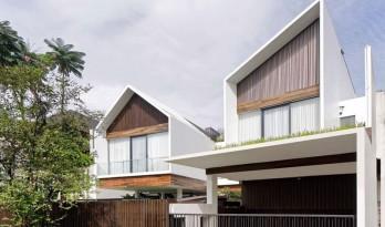 三个体量相互堆叠而成的印尼长屋住宅