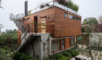 一抹暖色,隐于青葱:智利RH别墅 / Julio Zegers Arquitectos