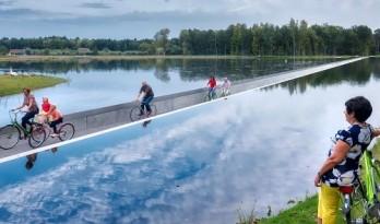 穿越水中的自行车道 / lens°ass architecten