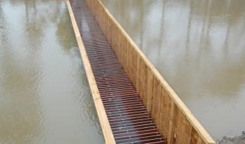 沉于水中的隐秘通道——摩西桥 / RO&AD