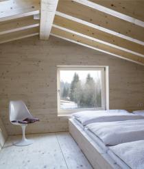 混凝土之上的温馨木屋